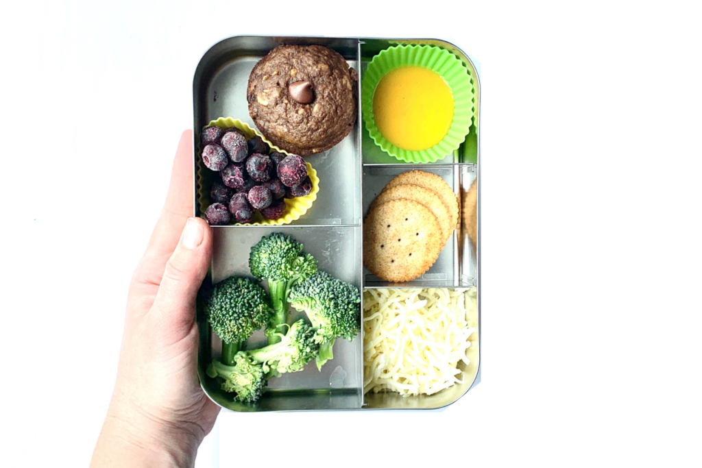 Lunch ideas for a picky eater, including, blueberries, banana lentil muffin with chocolate chips, broccoli, butternut squash soup, crackers and shredded cheese.